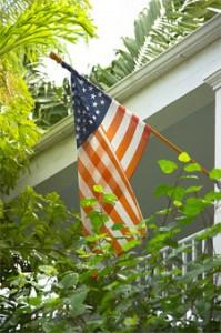 Flag flying days flagpole on a house.